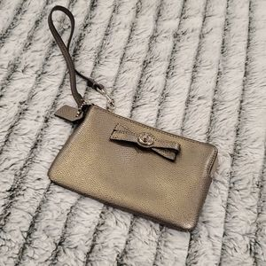 Cute metallic Coach bow wristlet